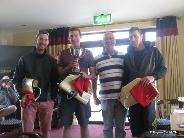Overall winners of the Mermaid Munster Championship 2016, 188 Innocence, helmed by Darragh Mc Cormack with crew Mark Mc Cormack and Cathal McMahon. Pictured here with Foynes Yacht Club Commodore James Mc Cormack.